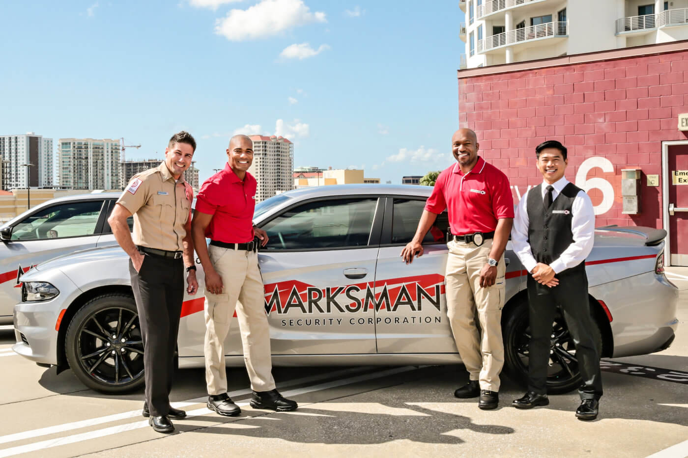 Marksman security team standing around car - we provides customized security solutions and security jobs